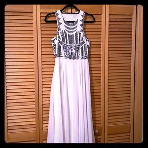 White floor-length dress with sequin detail
